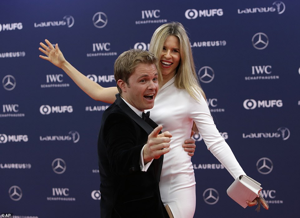前F1车手,2016年F1年度总冠军尼科·罗斯博格与妻子.jpg